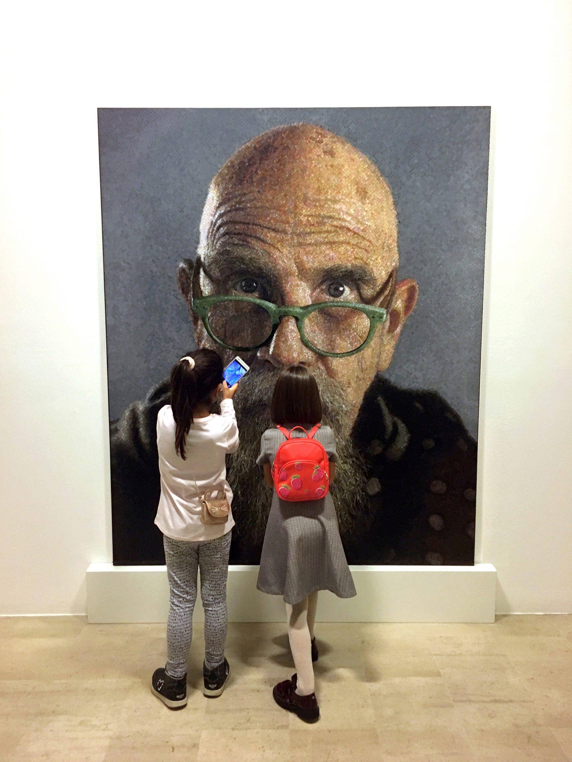 kids look at mosaic